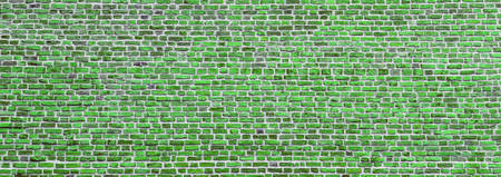 Brick wall, wide panorama of green masonry. Wall with small Bricks. Modern wallpaper design for web or graphic art projects. Abstract template or mock up.