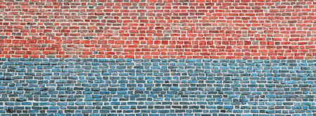 Brick wall, wide panorama of red and blue masonry. Wall with small Bricks. Modern wallpaper design for web or graphic art projects. Abstract template or mock up. Фото со стока