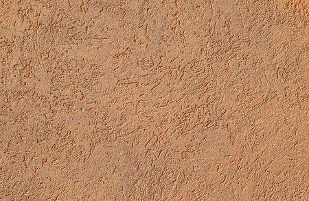 Terracotta getextureerde cement of betonnen muur achtergrond. Diepe focus. Mock-up of sjabloon voor modern design.