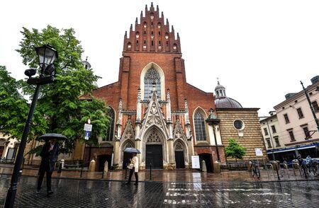Krakow, Poland - May 20, 2019: View on Old Basilica of Holy Trinity, Krakow Poland Editoriali