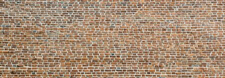 Brick wall, wide panorama of masonry. Wall with small Bricks. Modern wallpaper design for web or graphic art projects. Abstract template or mock up. Stock fotó