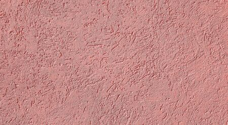 Pink Textured cement or concrete wall background. Deep focus. Mock up or template for modern design.
