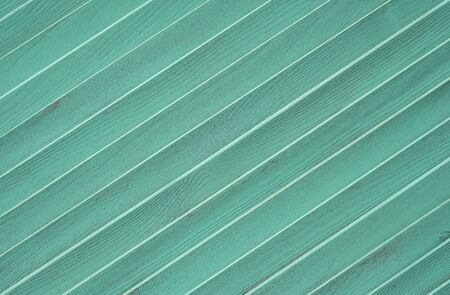 Wooden textured background with diagonal planks. Vintage mint wood background texture with knots Stock Photo