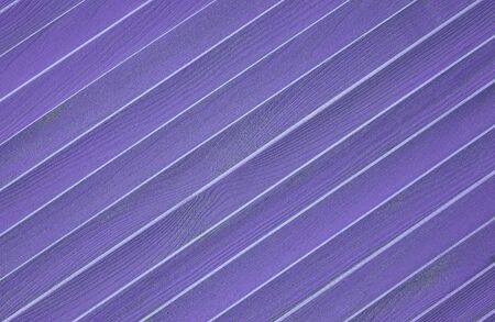 Wooden textured background with diagonal planks. Violet vintage wood background texture with knots