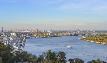 Kiev, Ukraine - October 10, 2019: Evening View on beautiful old Kyiv city - the capital of Ukraine and the Dnieper River Embankment