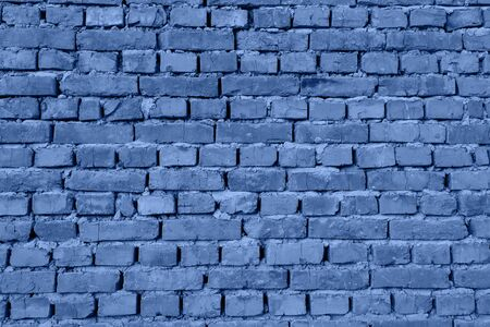 Beautiful modern funky loft wall background. Toned Blue pattern of style design decorative real stone wall surface. Trendy long banner toned in classic blue - color of the 2020 year
