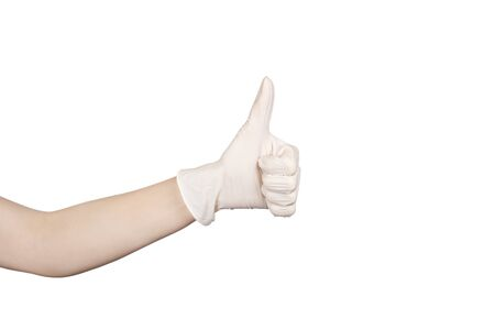 Hand showing thumbs up sign against white background. Hand in a white latex glove isolated on white. Womans hand gesture or sign isolated on white. Copy space