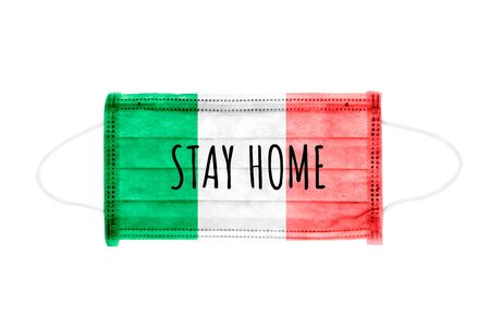 PP non-woven disposable medical face mask isolated on white background. Stay home lettering on medical mask toned in italy flag colors.