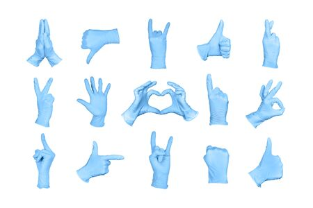 Big Set of hand or signs gestures in blue disposable latex surgical gloves isolated on white background. Hand sign set. 免版税图像