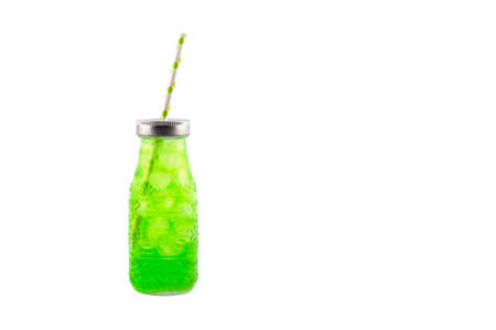 Lemonade or Cocktail Drink in coctail glass with straw and ice isolated on white background. Summer drink poster or banner with copy space.