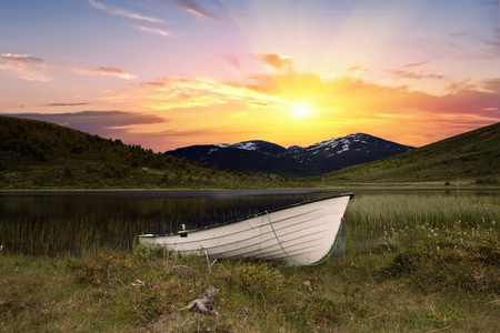 Boat in front of a river in jotunheimen norway Stock Photo