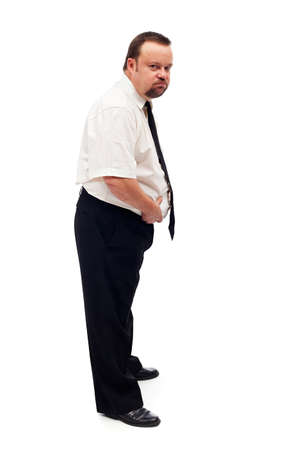 discontent: Overweight man assessing his problem holding belly in discontent - isolated