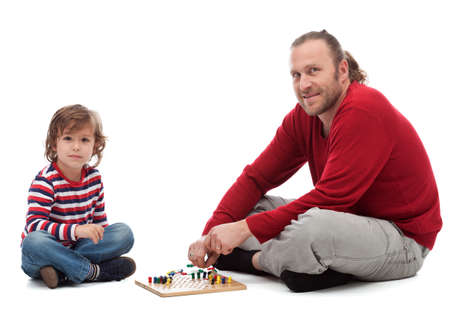 parlour games: Father and son playing parlour game