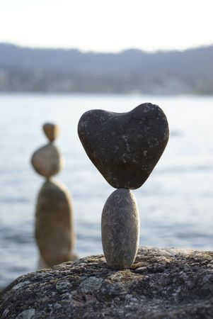 counterpoise: stone heart standing on the another stone       Stock Photo