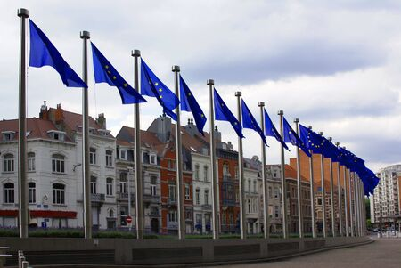flagpoles: Line of flags with symbols of Europe Union in Brussel