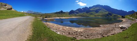 The tarn in swiss mountains and path for the hiking