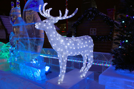 ice sculpture: Ekaterinburg, Russia - December 25, 2014: Ice sculpture of a deer. Christmas decoration