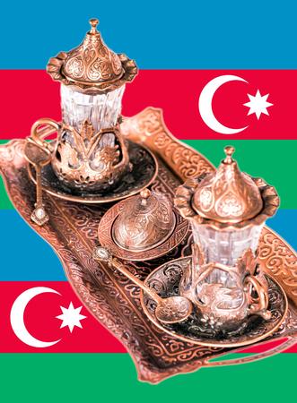 Azerbaijani tea set on the background of the flag of the Republic of Azerbaijan