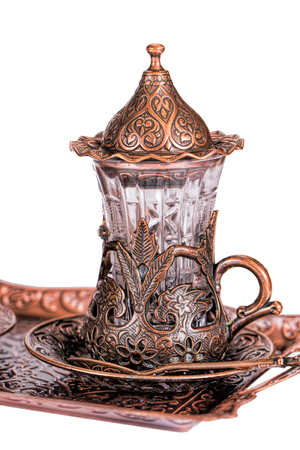 Turkish tea set. Ottoman teacup with traditional arabic ornaments on white background Stock Photo