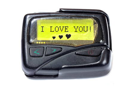 Old pager on a white background. The message on the screen: I LOVE YOU