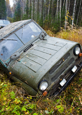 fourwheeldrive: NIZHNY TAGIL. RUSSIA - SEPTEMBER 22, 2012: Russian Plain Road in the heart of Siberia. Wheel drive vehicle leaves the swamp