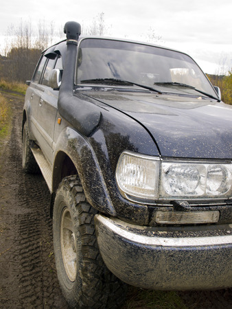 Off-road vehicle in the mud on a forest road