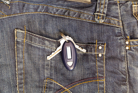 Keychain with the token in the jeans pocket Stock Photo