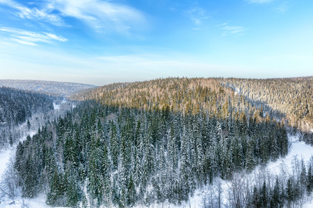 urals: Aerial view of snow-covered trees in the mountains