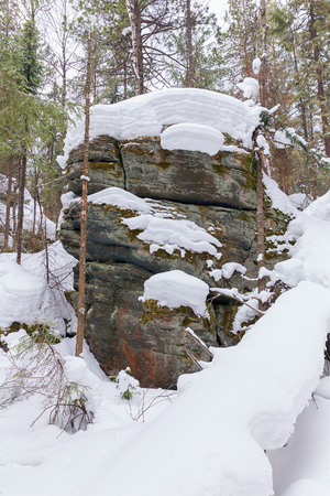 appearance: Rocks on the top of the mountain, covered with a thick layer of snow.
