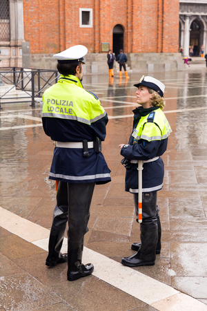 Venice, Italy - November 04, 2013: Italian police in Piazza San Marco. Venice is one of the most popular tourist destinations in the world