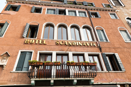most popular: VENICE, ITALY - NOVEMBER 04, 2013: Hotel Scandinavia in Venice. Venice is one of the worlds most popular tourist destinations with 21 million visitors per annum Editorial