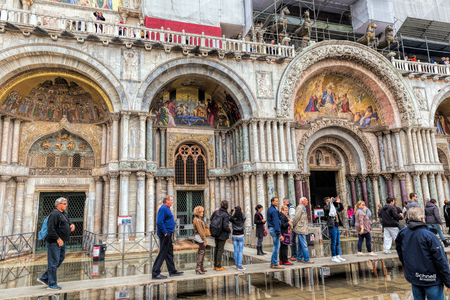 Venice, Italy - November 04, 2013: Architectural detail of the Doges Palace. Venice is one of the most popular tourist destinations in the world