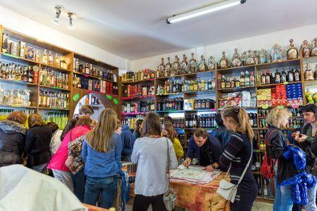 San Marino, Italy - November 06, 2013: People buy alcohol in a store San Marino