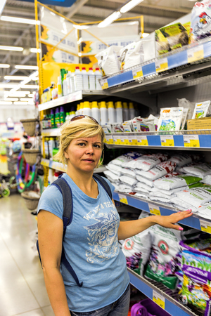 Woman chooses products in the agricultural product