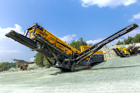 ridged: Open pit mining and processing plant for crushed stone, sand and gravel to be used in the roads and construction industry Stock Photo