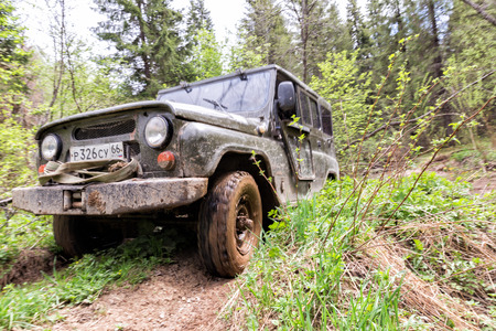 Ekaterinburg, Russia - June 02, 2016: UAZ car goes off-road. Bad roads in the north of the Ural Mountains