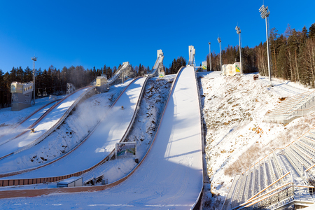 NIZHNY TAGIL, RUSSIA - DECEMBER 01, 2013: Complex of ski springboards against the blue sky. Height of 120 meters springboard Publikacyjne