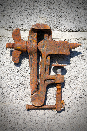 Old rusty vise on a fiery background