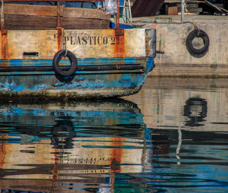 Fishing Boat Reflection Stock Photo - 90247641