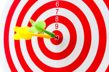 Bullseye is a target of business, dart is an opportunity and dartboard is the target and goal, a challenge in business marketing success concept. Stock Photo