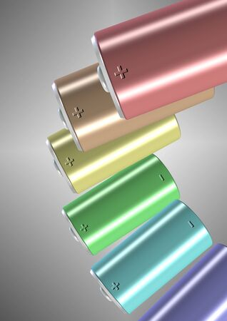A group of different colored batteries suspended in the air Stock Photo