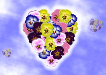 Pansy flowers forming shape of a heart on a blue sky background photo