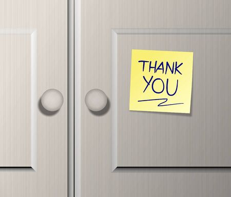 wooden post: Kitchen wooden cabinet doors with a text spelled thank you written on a post it note Stock Photo