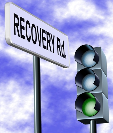 recovery: A street sign spelling recovery with a traffic light on green in the background