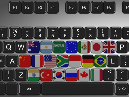 g20: computer keyboard filled with flags of G20 group Stock Photo