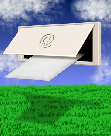 inbox: letterbox with at symbol on it in front of green grass field and blue sky Stock Photo