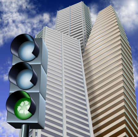 Traffic light with a recycle symbol on it and city skyscrapers in the background photo