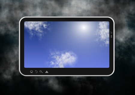 stormy clouds: Computer tablet with blue sky on the screen and stormy clouds in the background Stock Photo