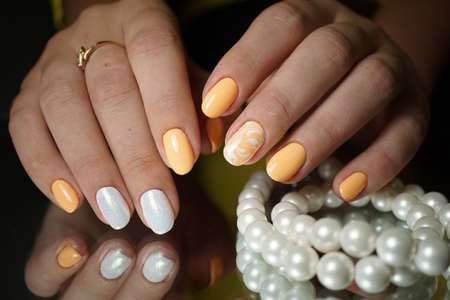 Beautiful bright natural nails with perfect clean manicure. Nail drill machine and cuticle nipper are used simultaneously to make such a clean manicure.