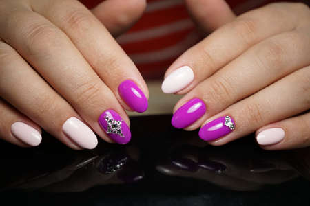 simultaneously: Beautiful bright natural nails with perfect clean manicure. Nail drill machine and cuticle nipper are used simultaneously to make such a clean manicure.